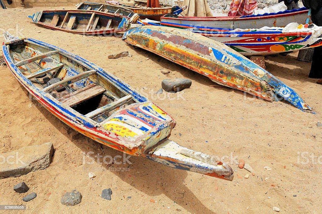 Fishing boats stranded on the beach. Goree island-Dakar-Senegal. 1885 stock photo