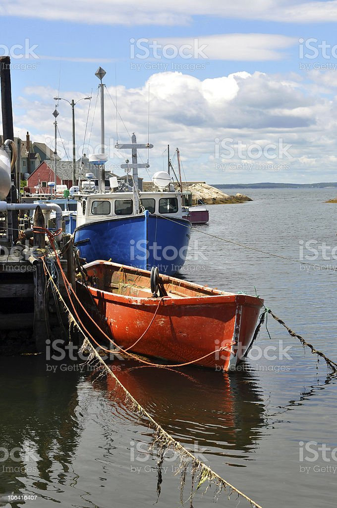 Fishing boats tied to a wharf stock photo