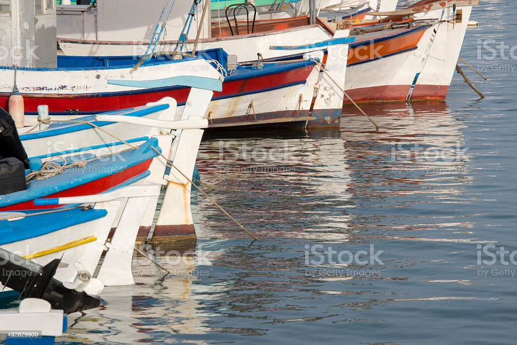 Fishing boats with reflections stock photo