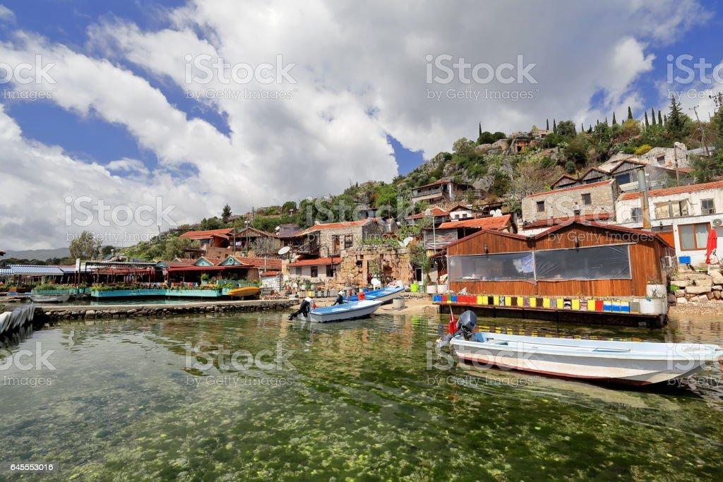 Fishing boats-pier-houses of Kaleköy-Castle Village. Ancient city of Simena-Lycia-Turkey. 1023 stock photo
