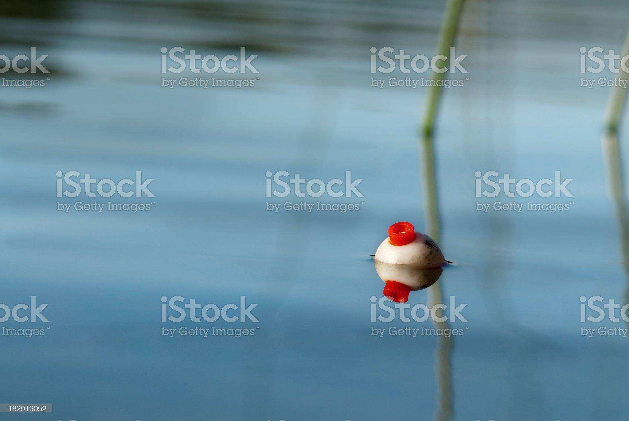 Fishing bobber on still water royalty-free stock photo