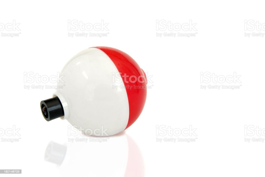 Fishing Bobber Sitting on a Reflective Surface and White Background stock photo