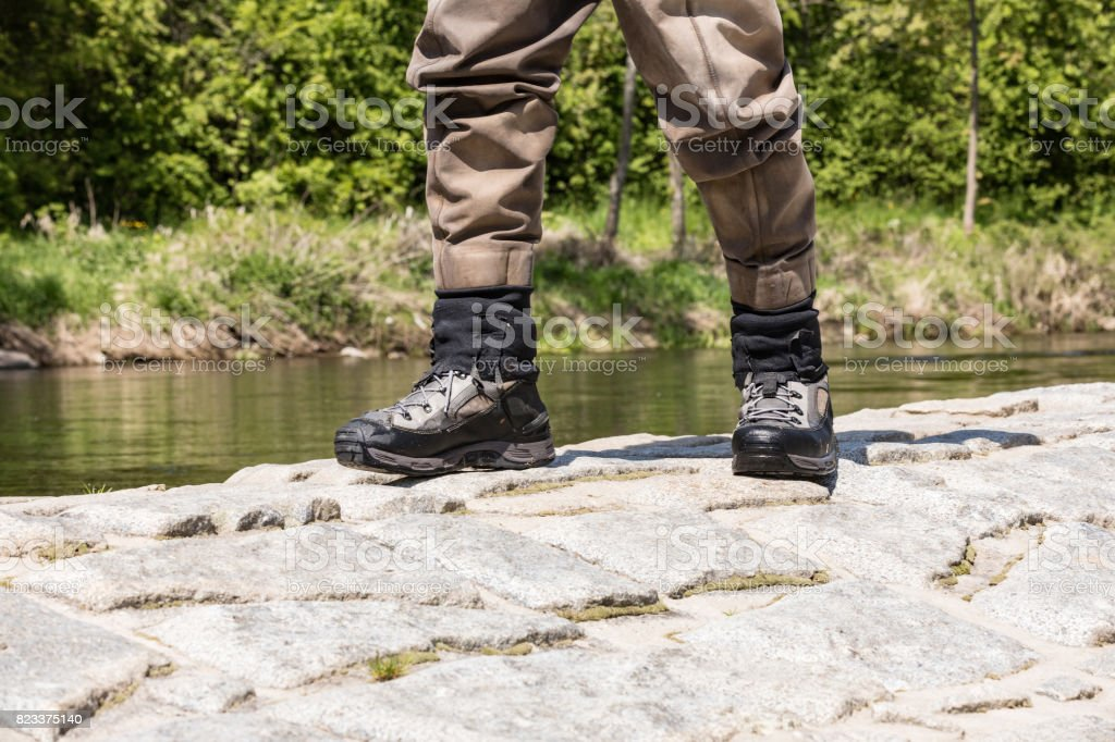 Fishing boots for wading in the river. Special fishing boots for fly fishing. stock photo