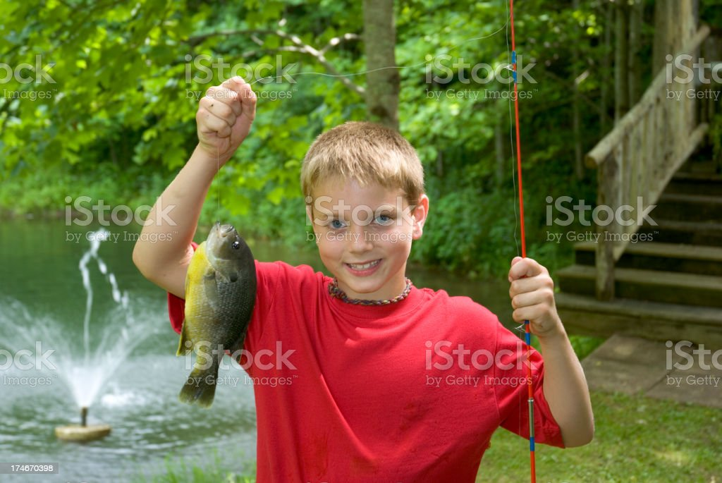 Fishing Boy Holding Up A Big Fish (Bluegill) royalty-free stock photo