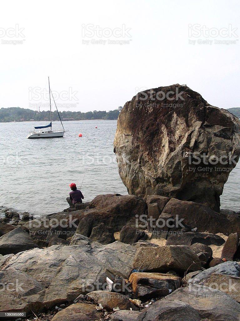 Fishing by Big Rock royalty-free stock photo
