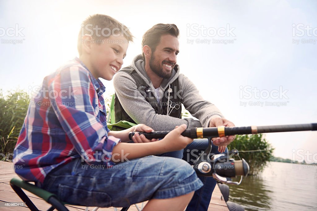 Fishing by the lake is our common passion stock photo