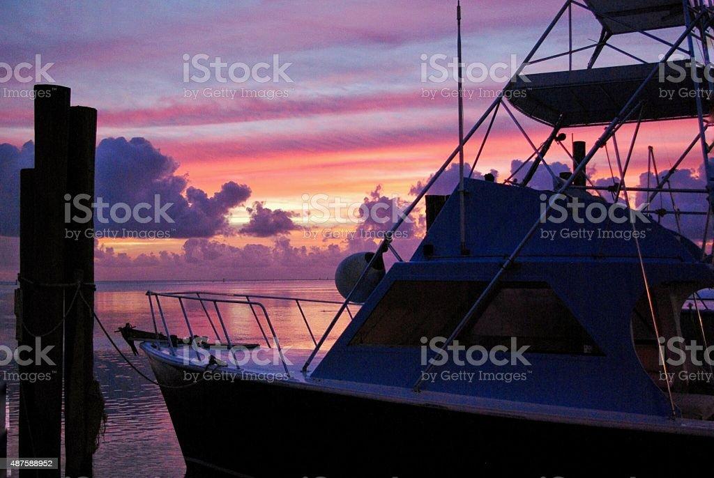 Fishing charter boat silhouette stock photo