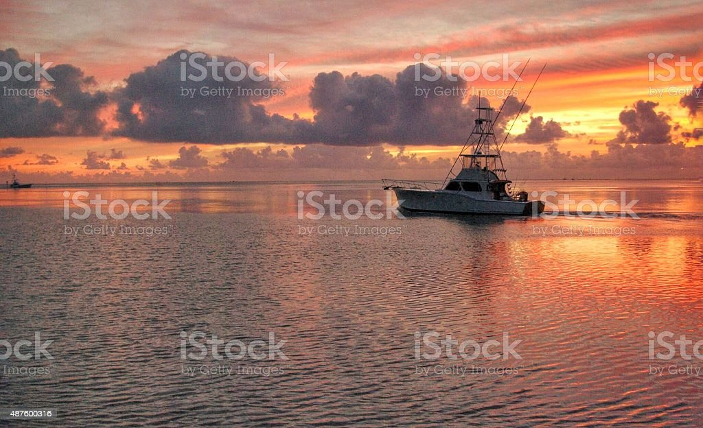 Fishing charter departs stock photo