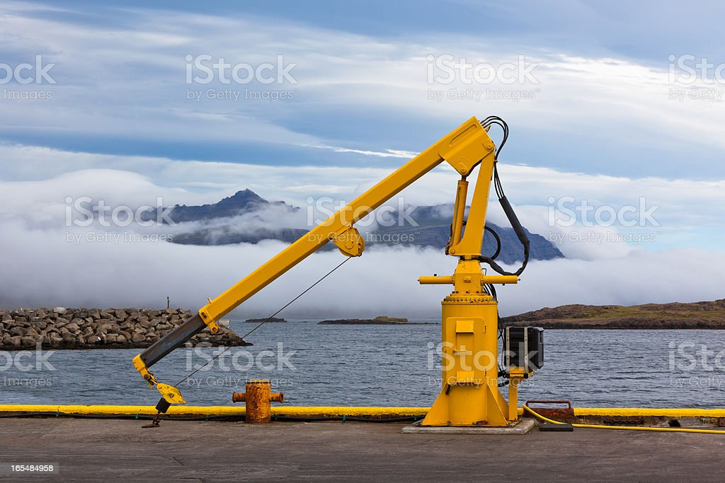 Fishing crane in small seaside Iceland town harbor. royalty-free stock photo