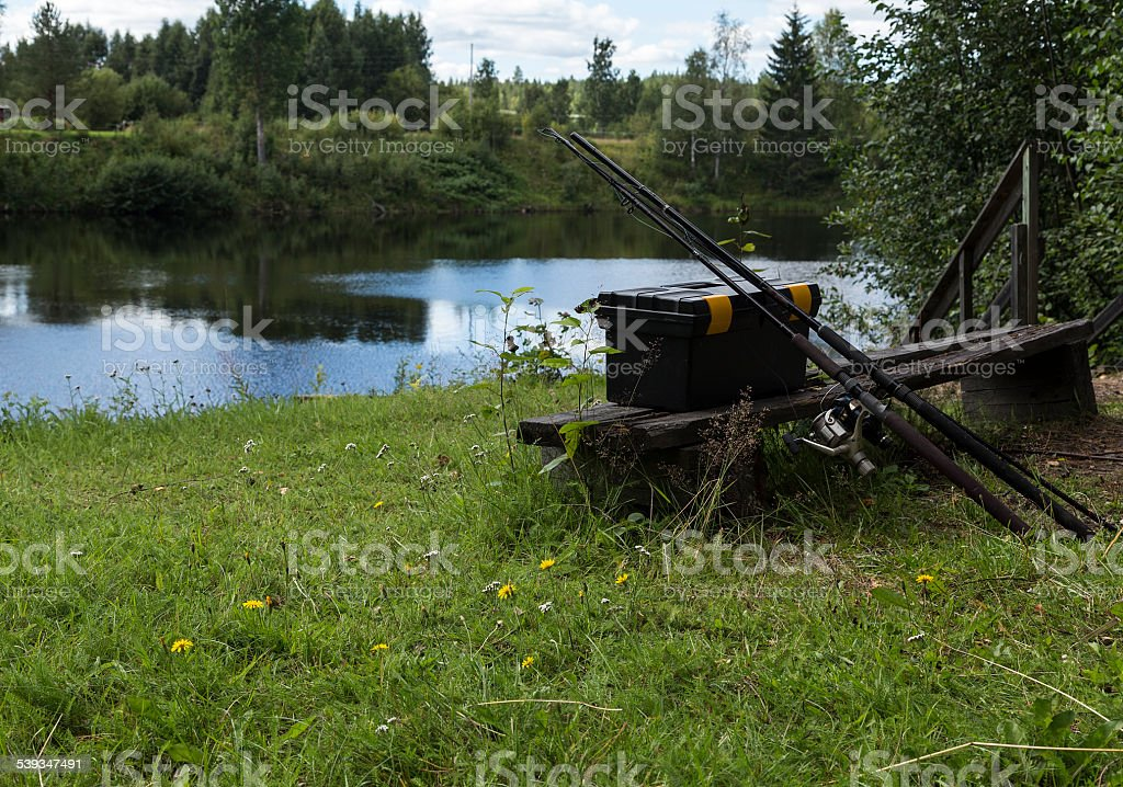 Fishing equipment on a bench royalty-free stock photo