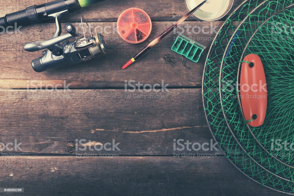 fishing equipment on old wooden table with copy space stock photo