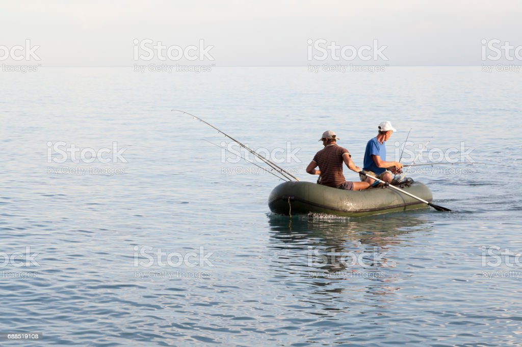Fishing. Fisherman on the boat. stock photo