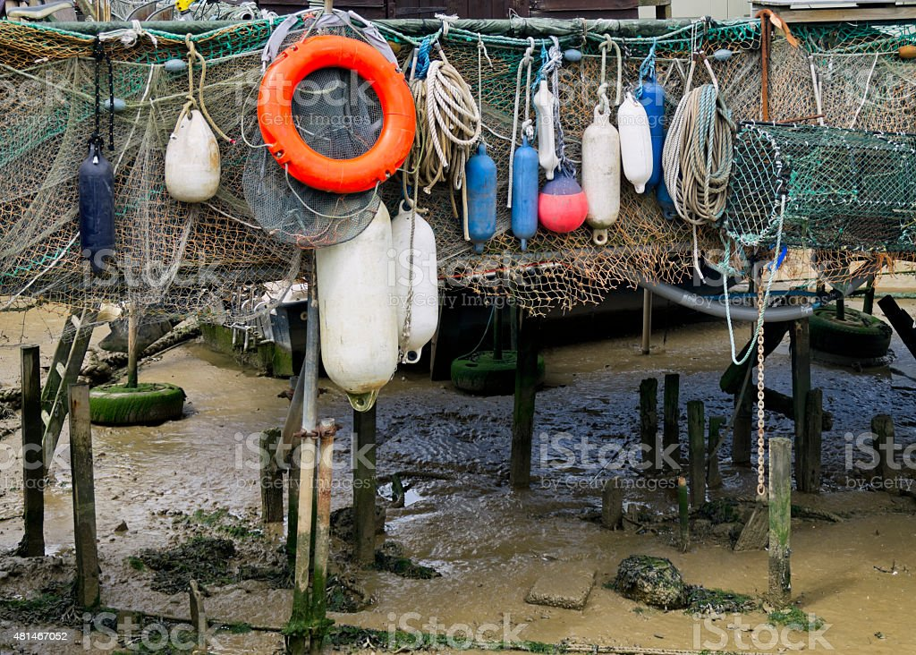 Fishing floats, nets and ropes on a jetty stock photo