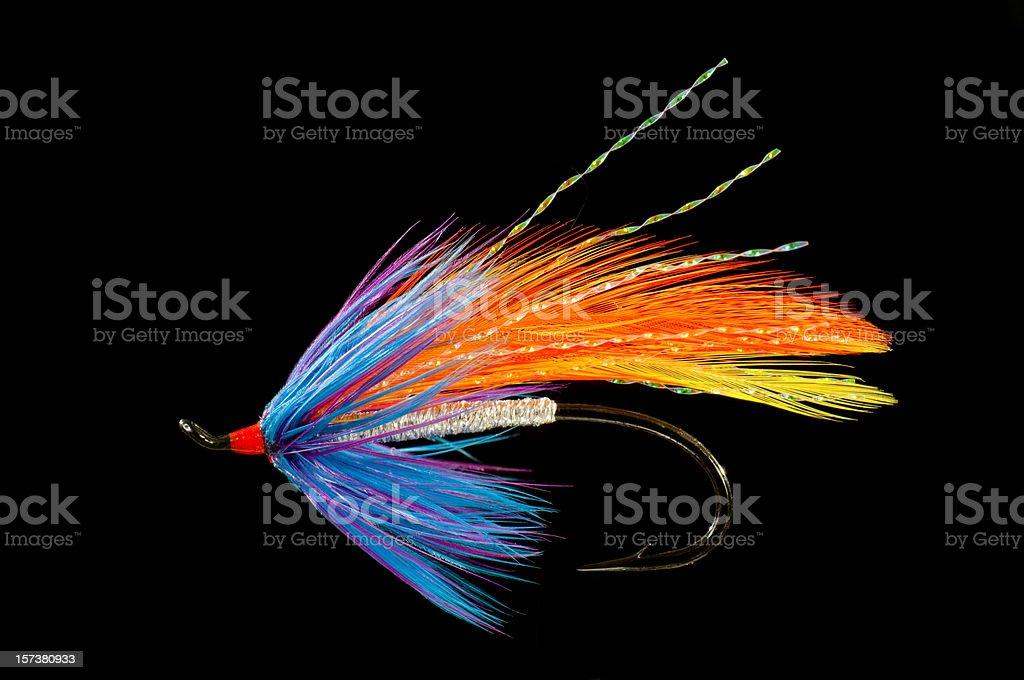 Fishing fly, blue, orange and yellow stock photo