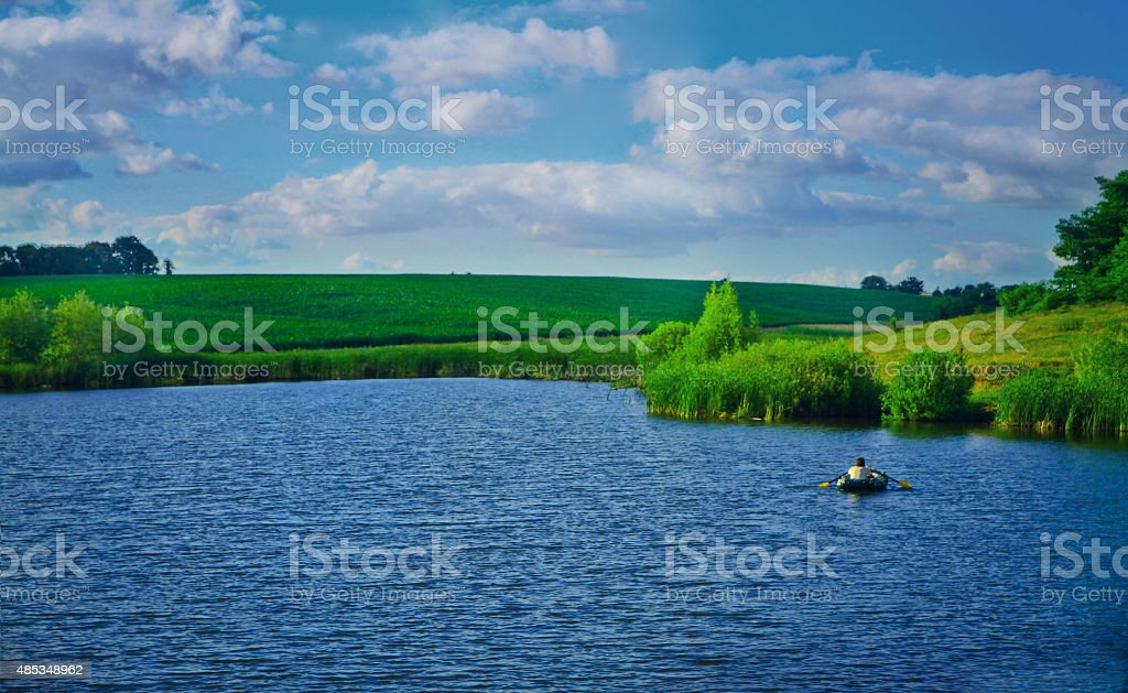 Fishing from a boat on the lake. river, pond stock photo