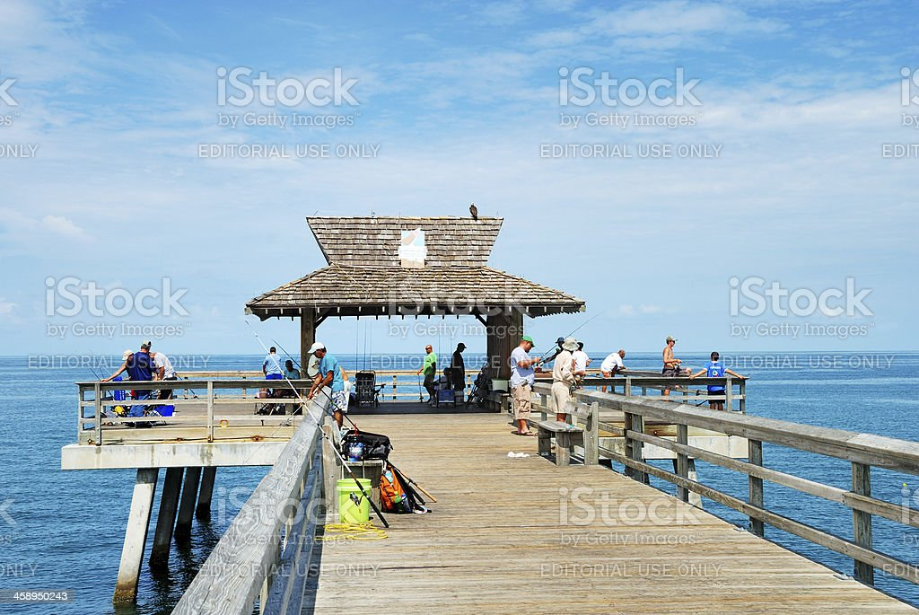 Fishing from Naples pier in southwest Florida stock photo