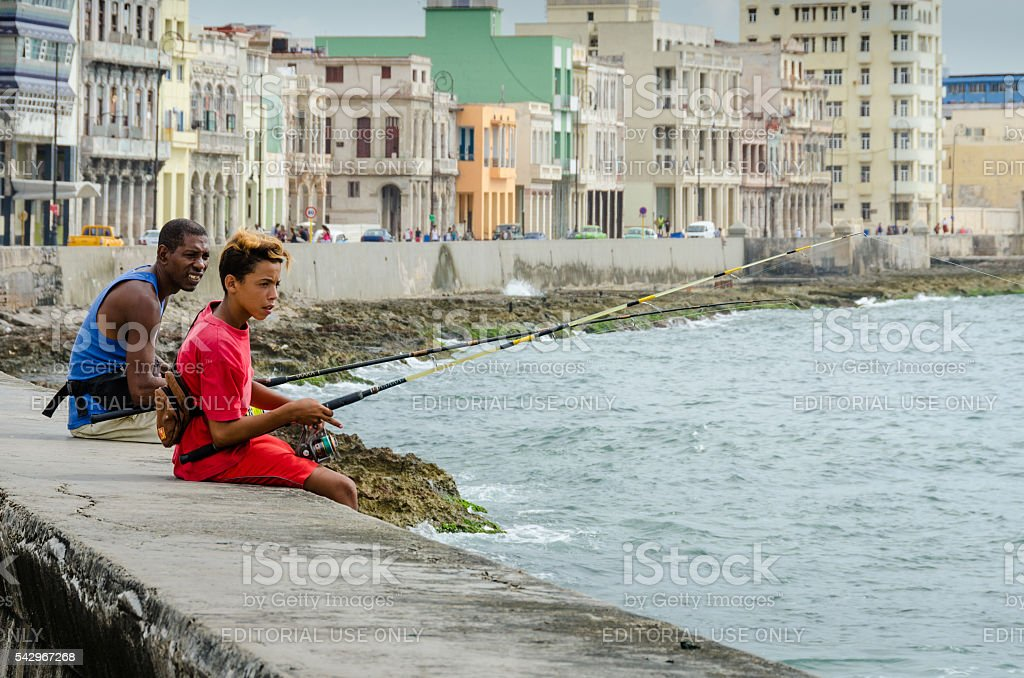 Fishing from the seawall in Old Havana stock photo