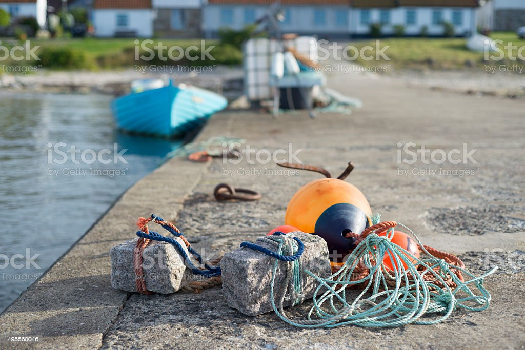 Fishing gear - buoy, anchors, ropes  - on the pier stock photo