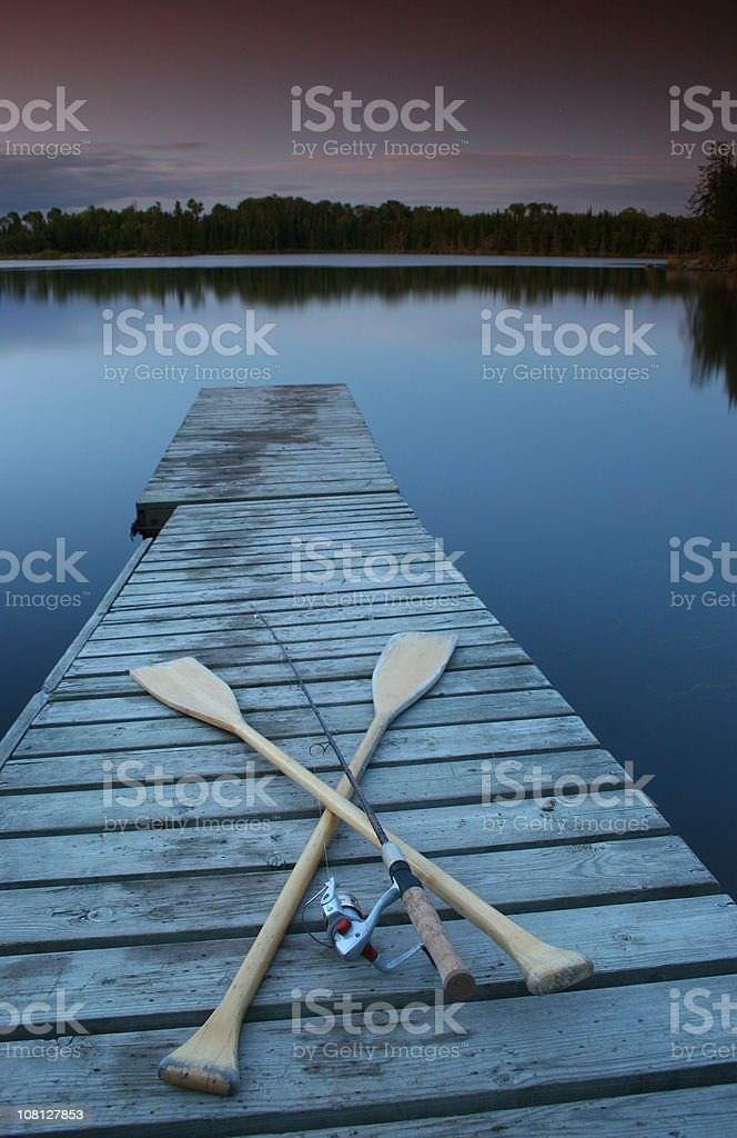 Fishing Gear on Lake Dock at Dusk royalty-free stock photo