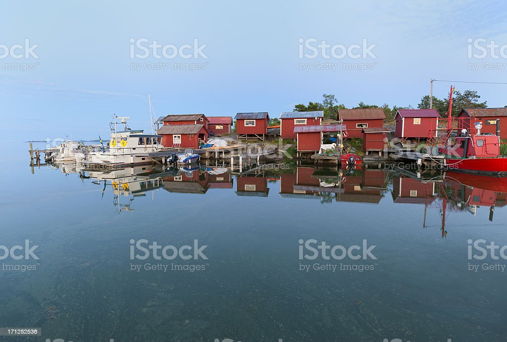 Fishing harbour at sunset stock photo