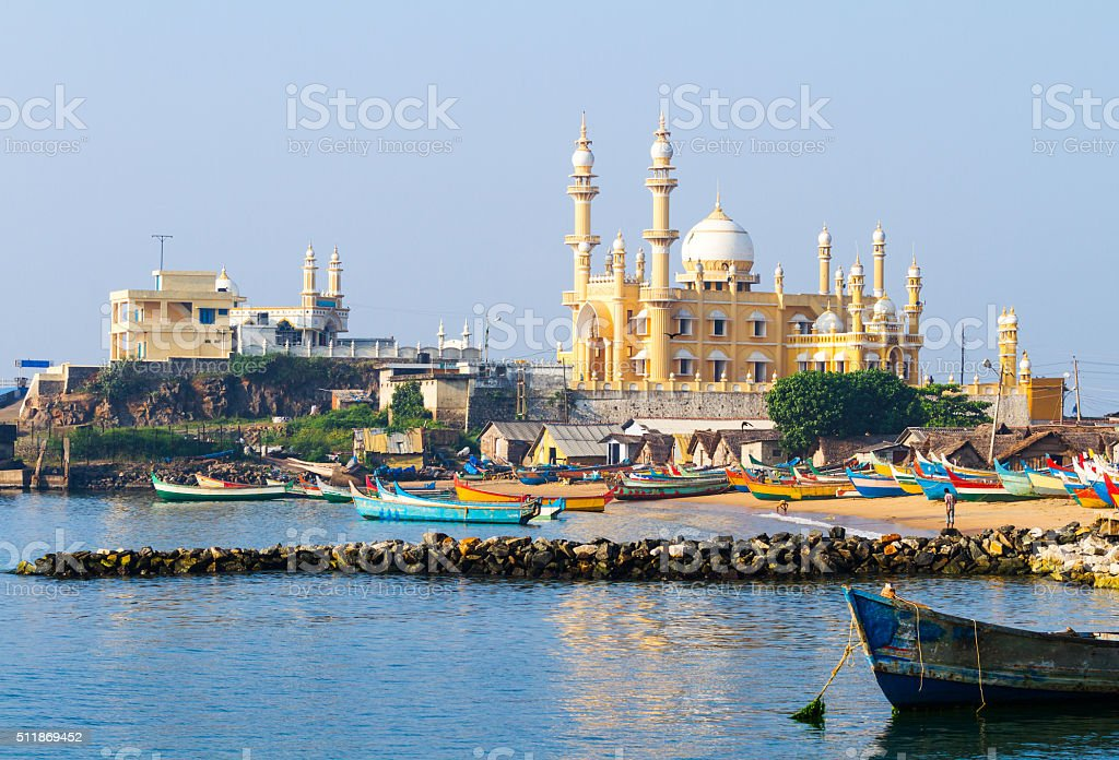 Fishing harbour with mosque in the background (Arabian Sea, India) stock photo