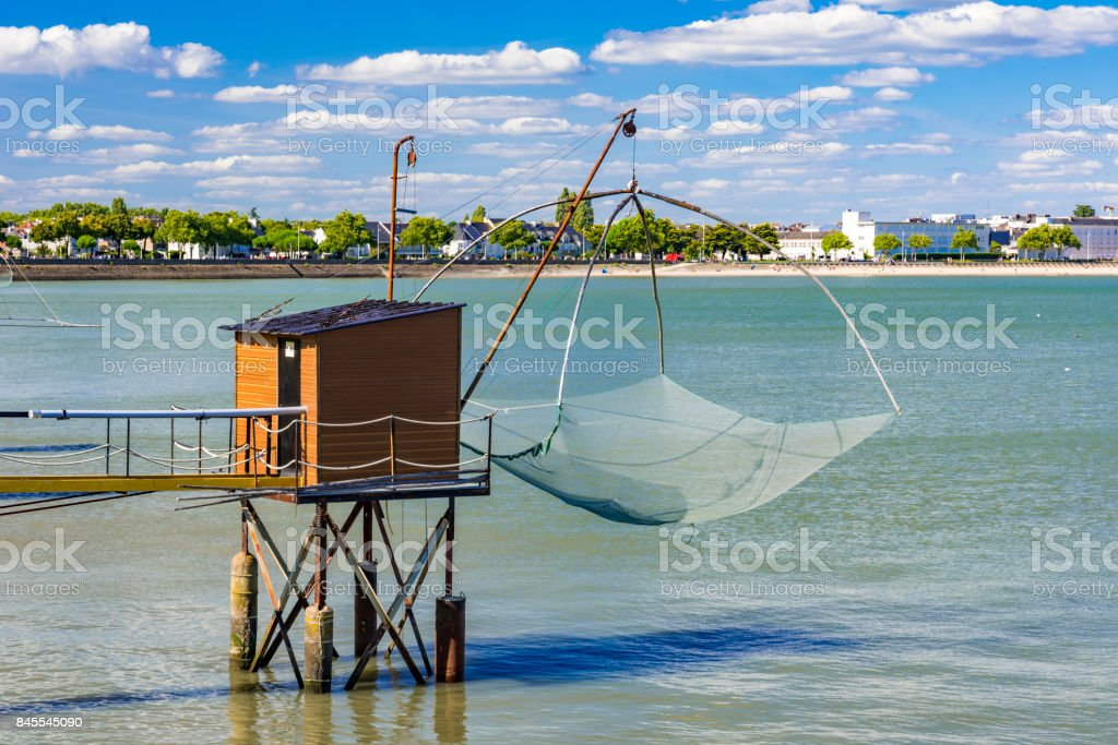 Fishing huts and nets in St Nazaire, France stock photo