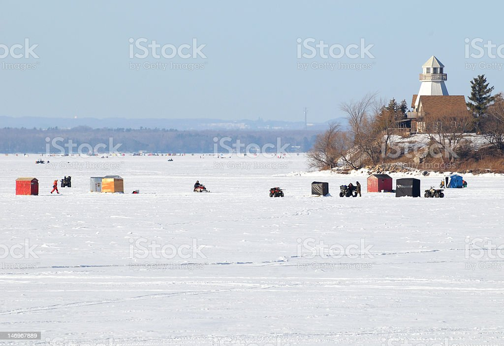 Fishing huts and snowmobiles royalty-free stock photo