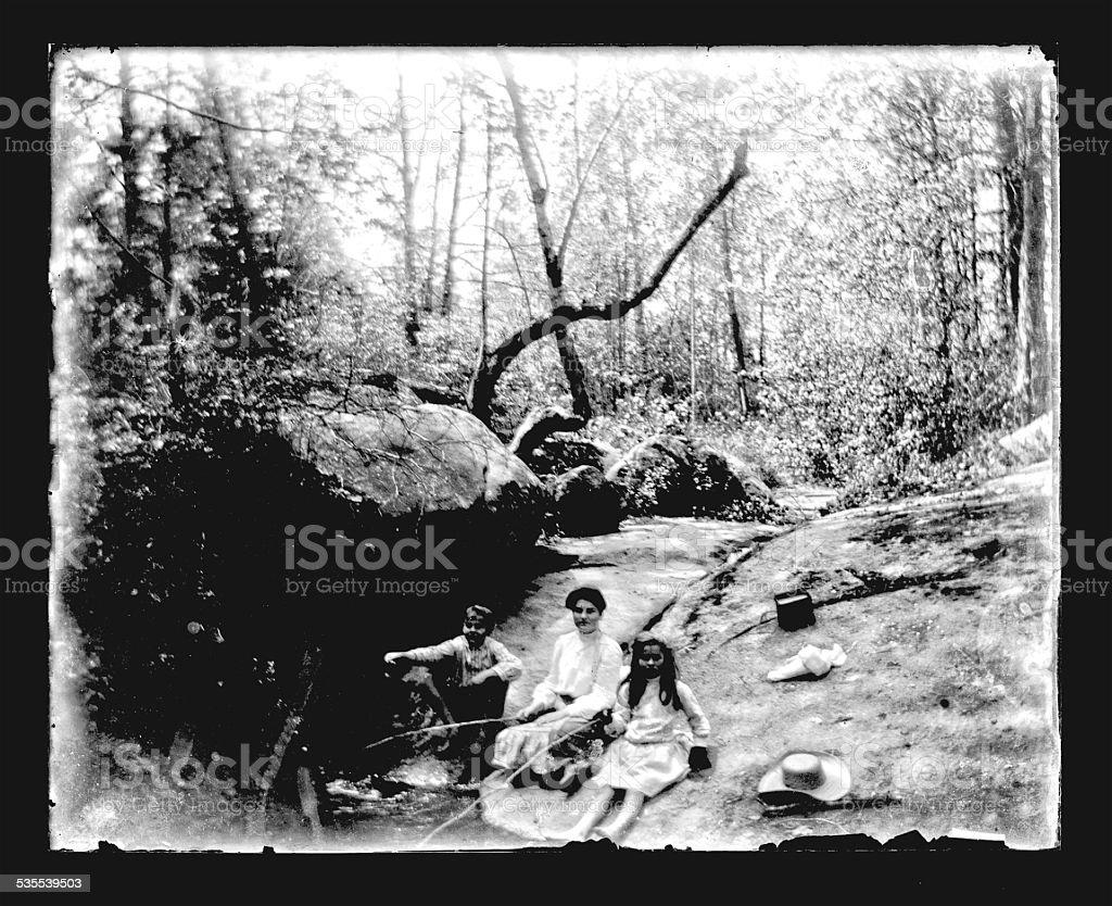 Fishing in a Stream, Circa 1890 stock photo
