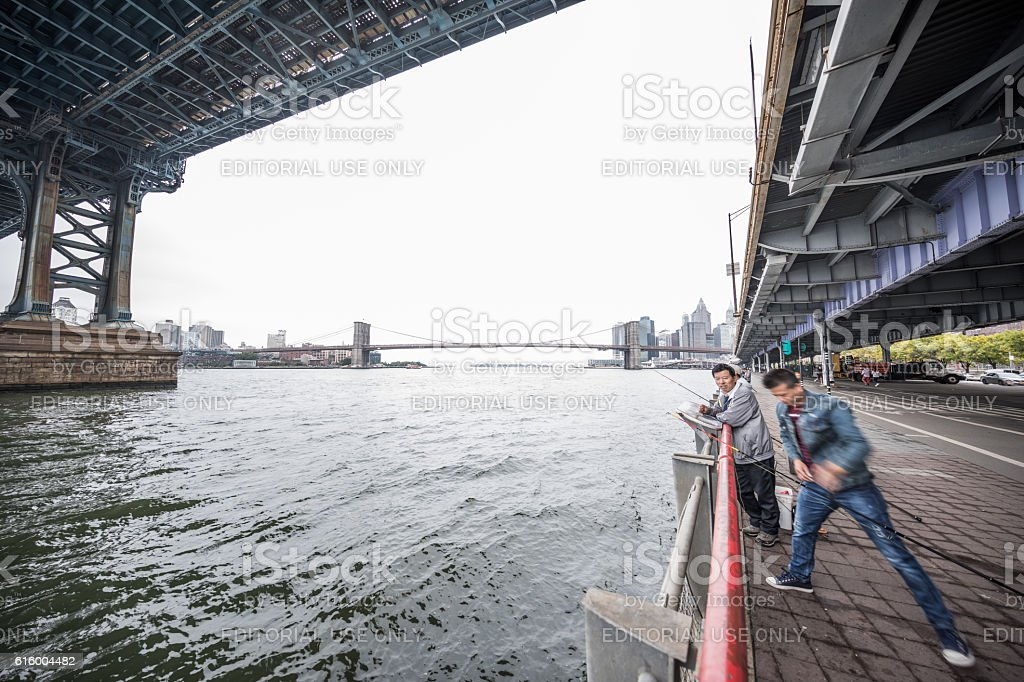 Fishing in East River, Manhatten, New York City, United States stock photo