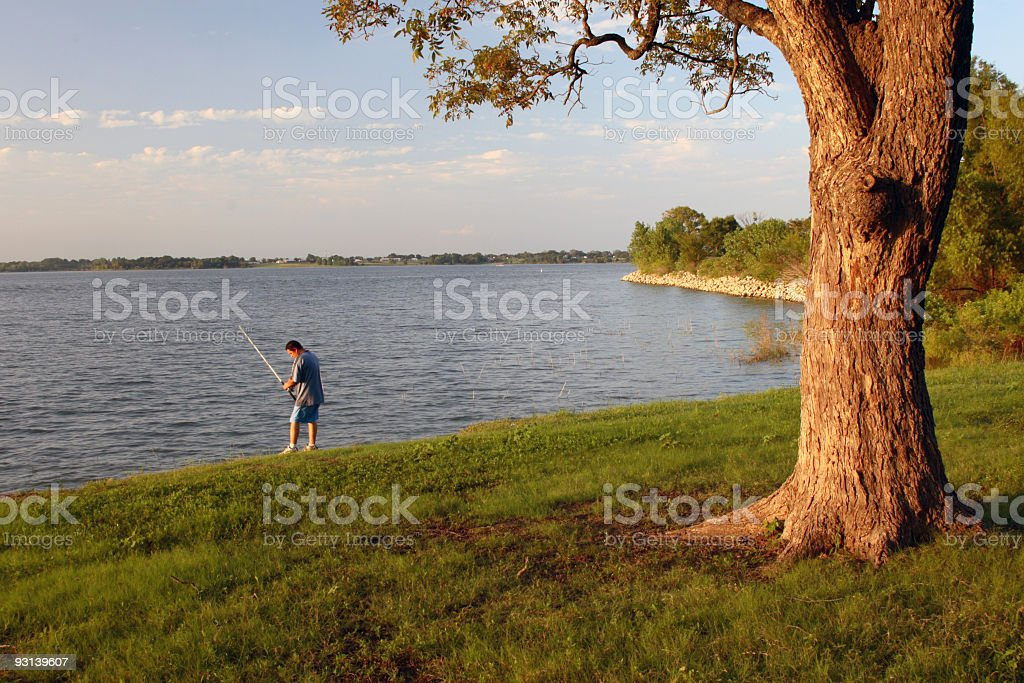 fishing in lake royalty-free stock photo