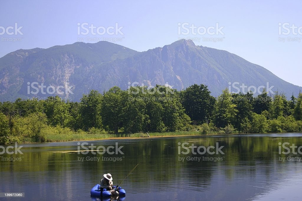 Fishing in Skyblue Lake royalty-free stock photo