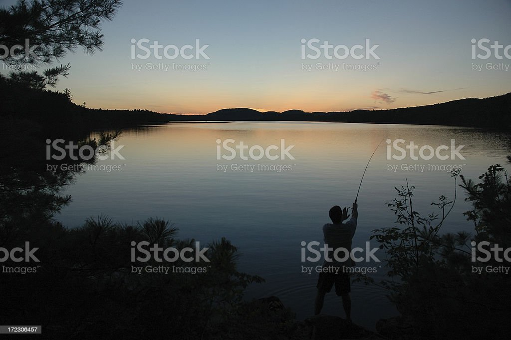 Fishing in the Evening royalty-free stock photo