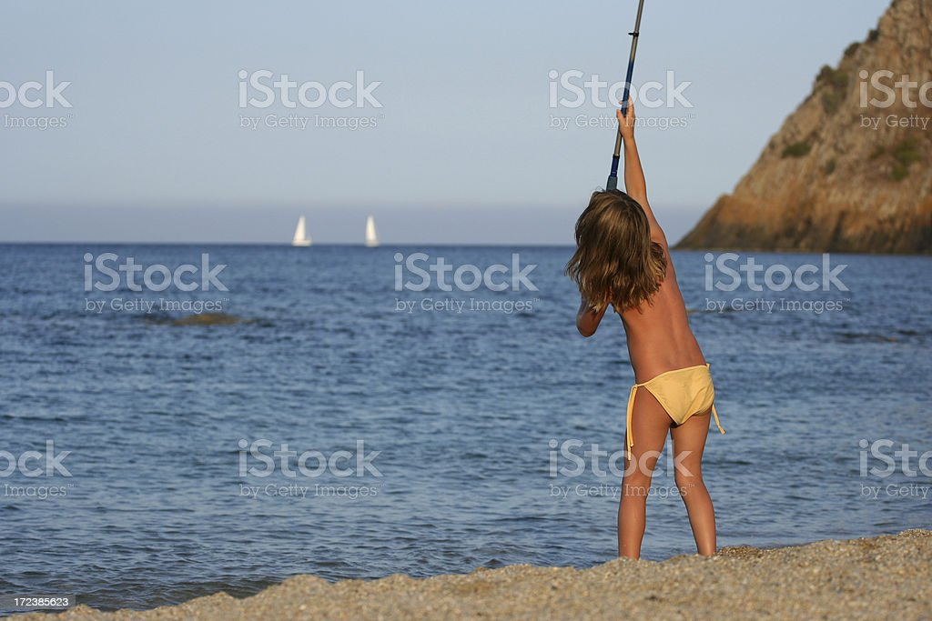 Fishing in the sunset light royalty-free stock photo