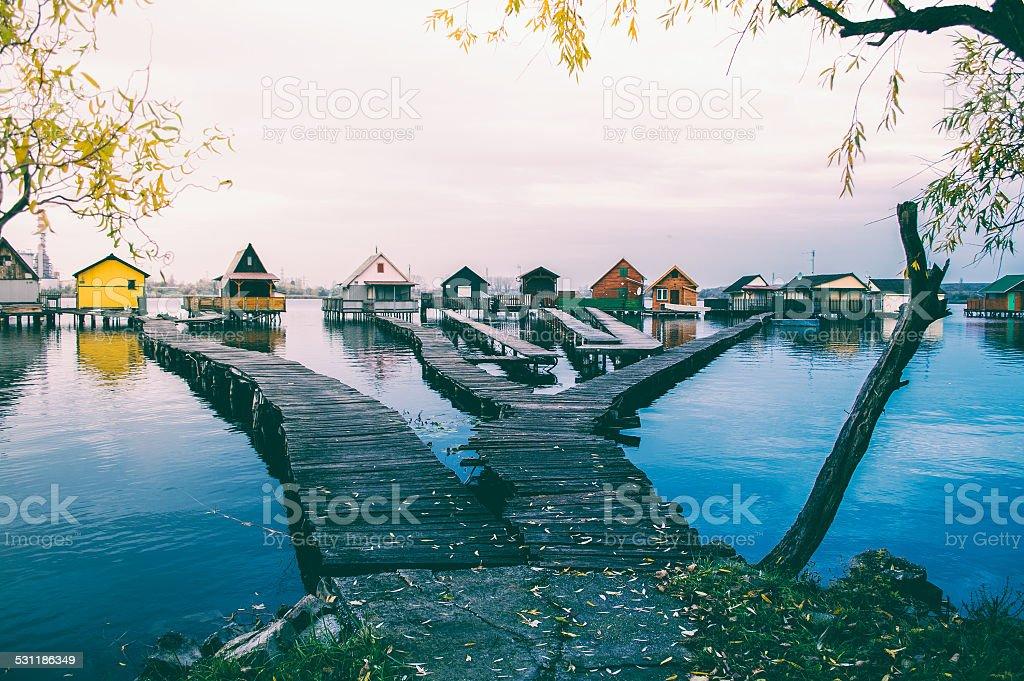 Fishing lodge on lake - landscape stock photo