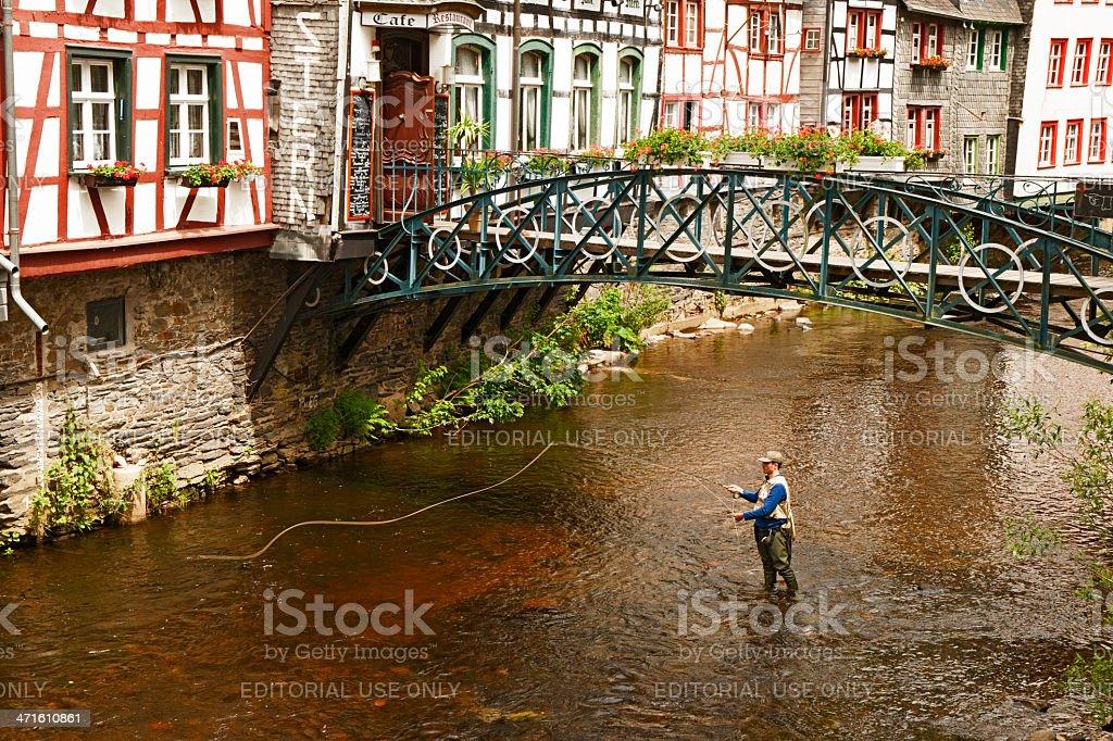 Fishing men at the Rur royalty-free stock photo