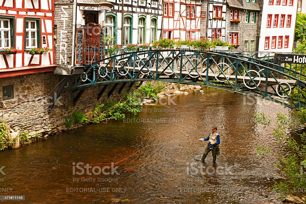 Fishing men at the Rur royalty-free stock photo