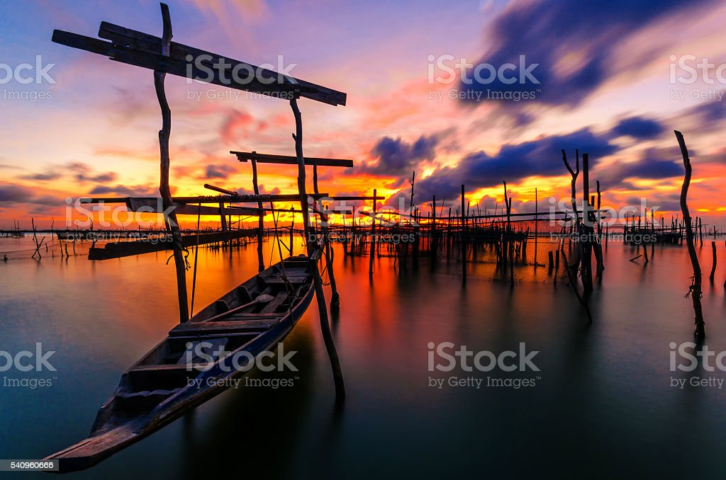 fishing moored at sea. Clouds and light evening twilight stock photo