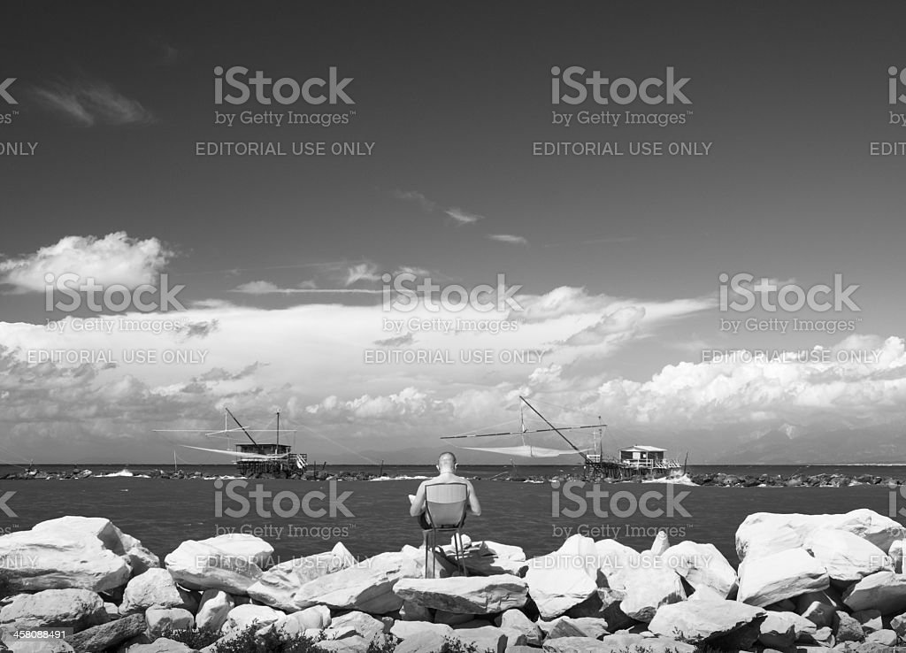 Fishing near mouth of the river royalty-free stock photo