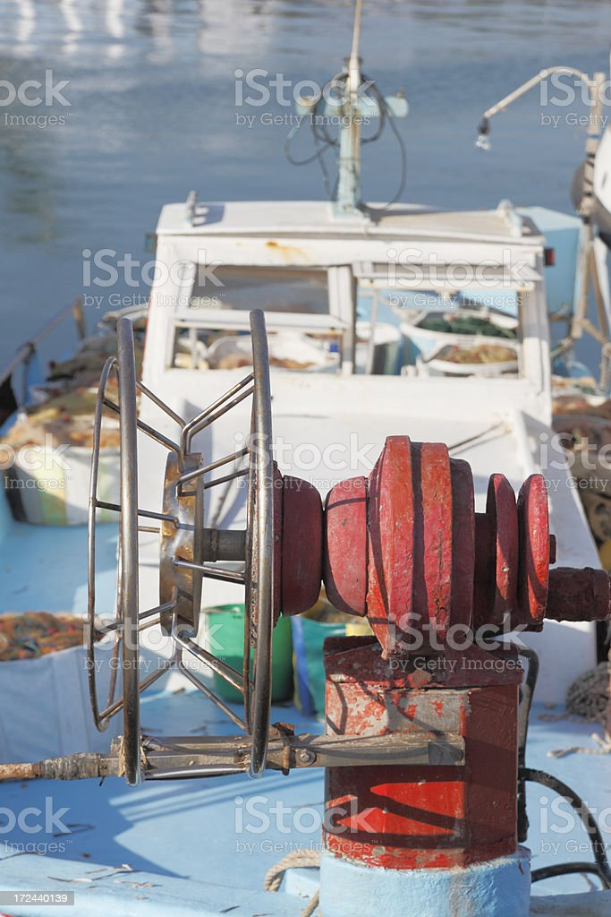 fishing net and buoy spool on boat Cyprus royalty-free stock photo