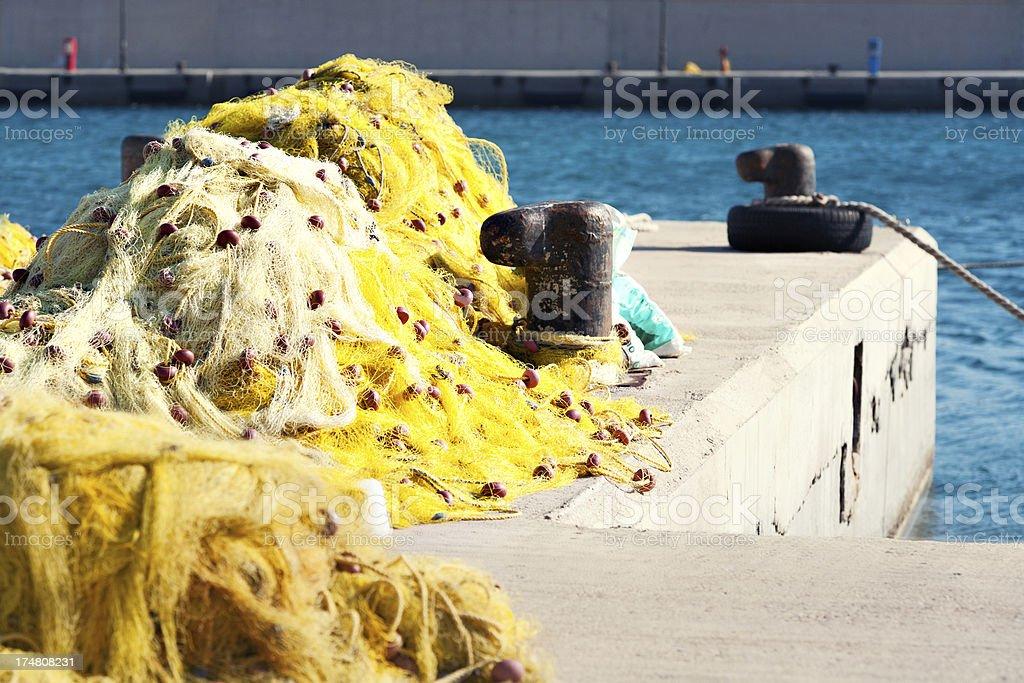 Fishing net at the harbor royalty-free stock photo