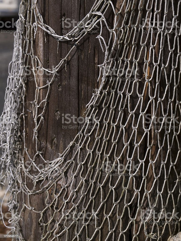 fishing net close up on pier royalty-free stock photo
