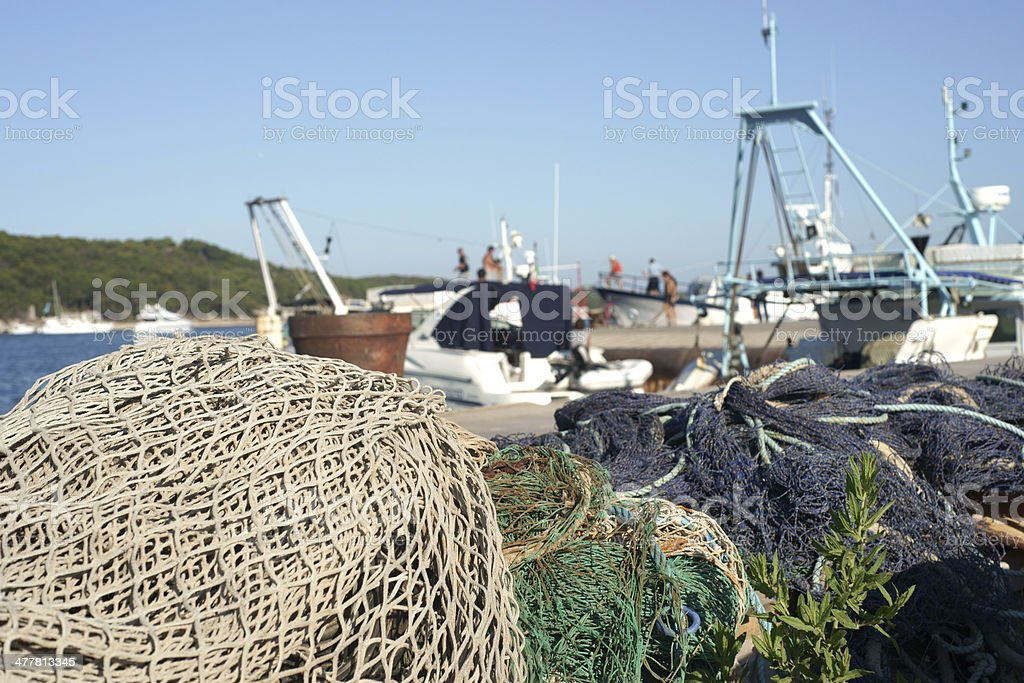 Fishing net in front of ships royalty-free stock photo