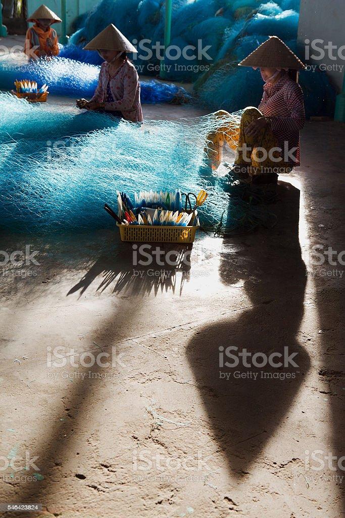 Fishing net mending in Bac Lieu, Mekong Delta, Vietnam stock photo