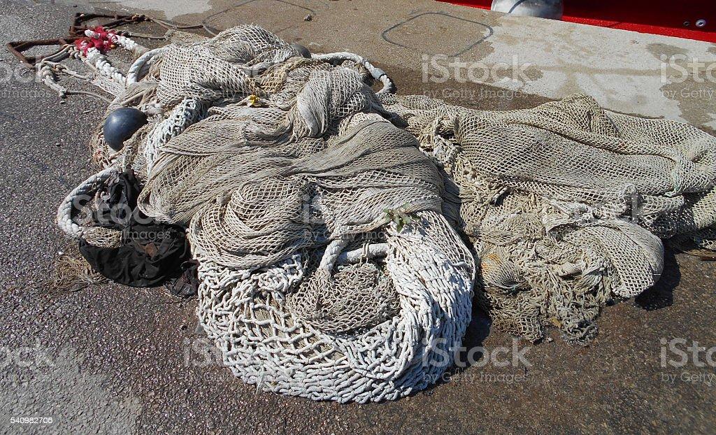 Fishing net on the dock stock photo