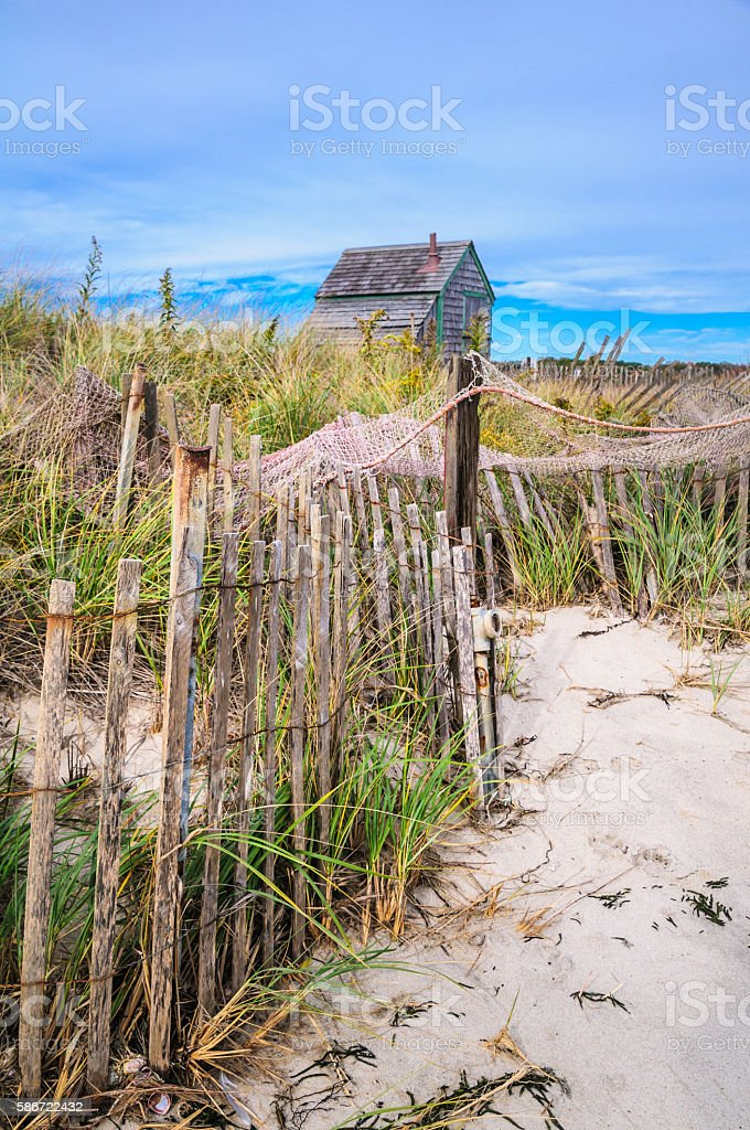 Fishing Net on ths Sand Fence stock photo