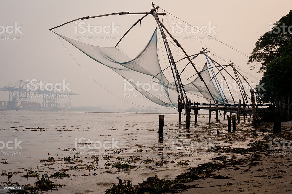 Fishing nets and boat in Cochin (Kochi), Kerala, India stock photo