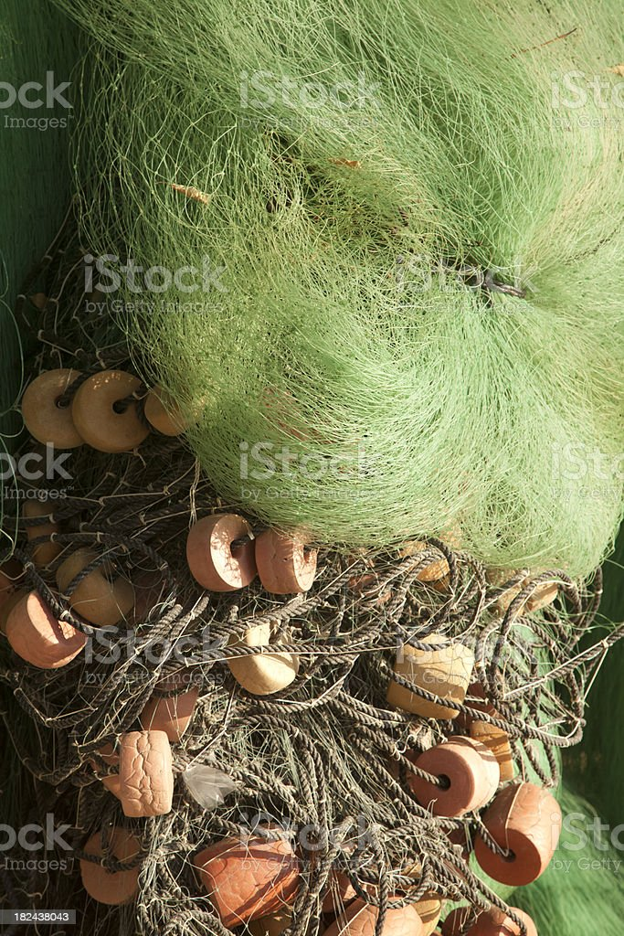 Fishing Nets and Floats on Beach, Close Up royalty-free stock photo