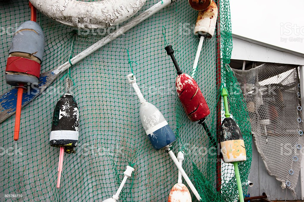 Fishing nets and lobster buoys on the wall stock photo