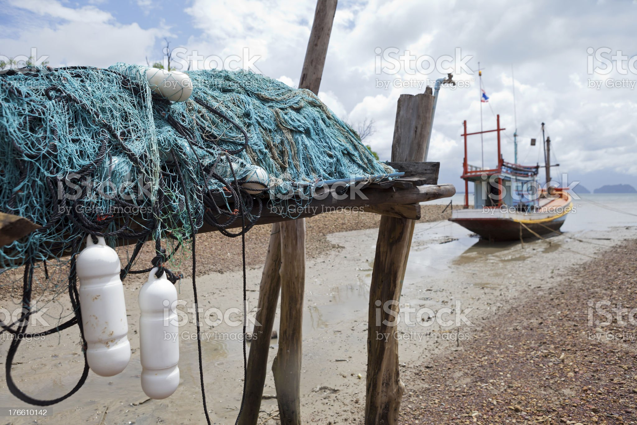 Fishing nets and old moored boat. royalty-free stock photo