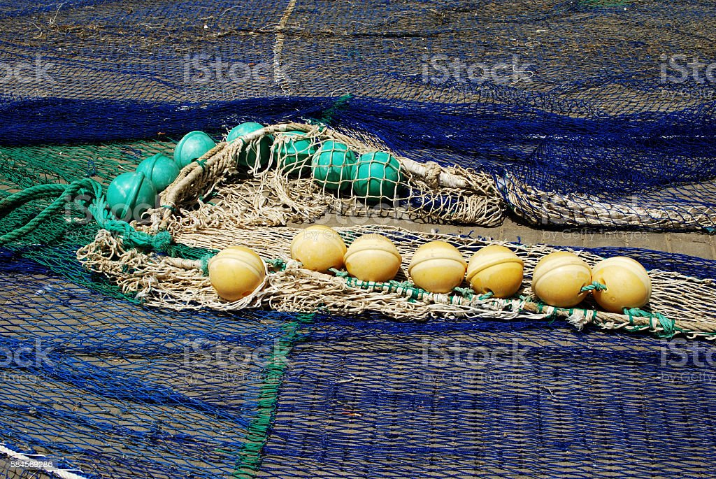 Fishing nets drying in the sun, Estepona. stock photo